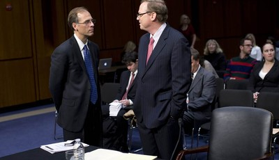 Mark Zandi, chief economist at Moodys Analytics, left, speaks with Kevin Hassett, senior fellow and director of Economic Policy at the American Enterprise Institute (AEI), on Capitol Hi